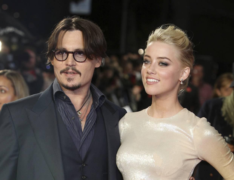 Actress Amber Hear with husband Johnny Depp